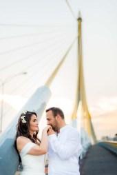 Wedding photo taken on Rama VIII Suspension Bridge in Bangkok, Thailand.
