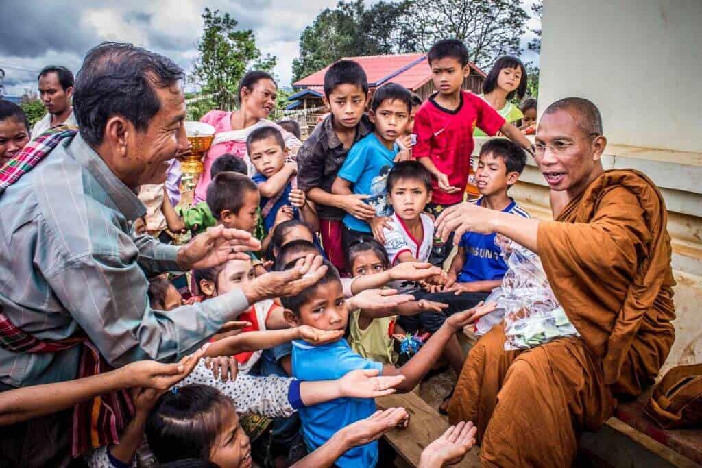 Thai monk with children. Thailand Event Guide
