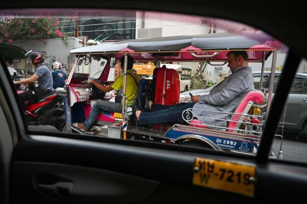 Tourism slows down in Thailand. This man enjoys a tuk tuk ride. Thailand Event Guide