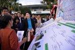 Buriram - Yingluck listening to a briefing