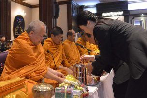 Yingluck offering alms to monks
