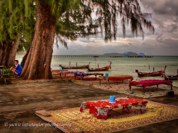 eating tables under tree along the water strong color impression