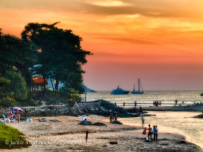sunset Nai Haen Beach families play