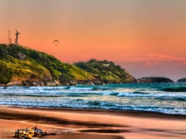 old fish net on beach para glider sunset Nai Harn Phuket