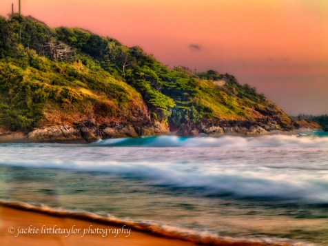 soft large swells rolling in beach sunset impression