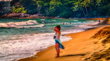 lovely tourist with camera sunset beach impression 16x9 Surin