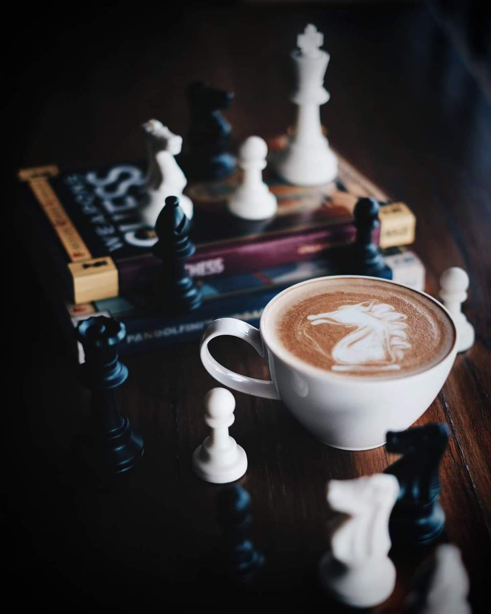 A close up of coffee and chess.