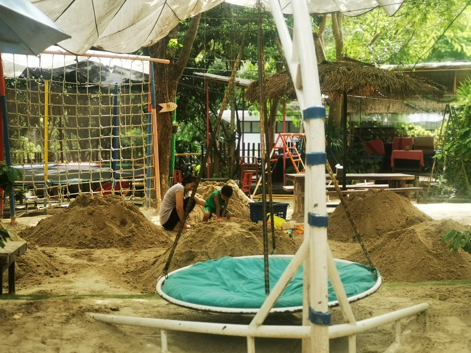 Restaurants with playgrounds in Chiang Mai. A trampoline at Cup Fine Day.