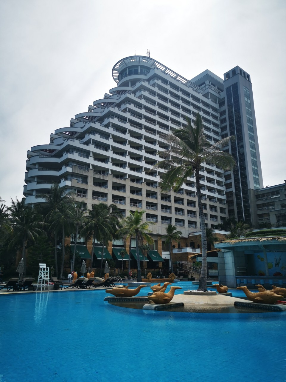 Pool and building view of Hilton
