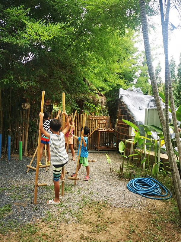Walking on stilts in a play space in Chiang Mai