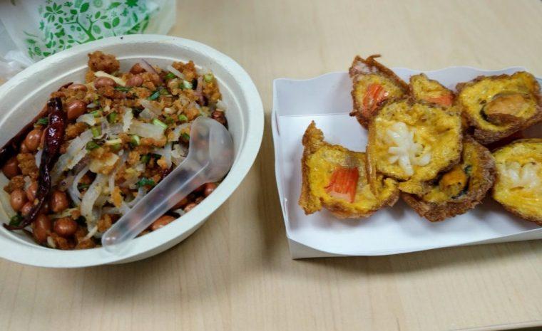 Yam naem pork sausage salad and crispy oyster pancakes Bangkok
