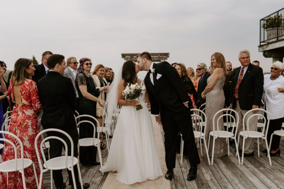 bride and groom ceremony at trumpets at the gate