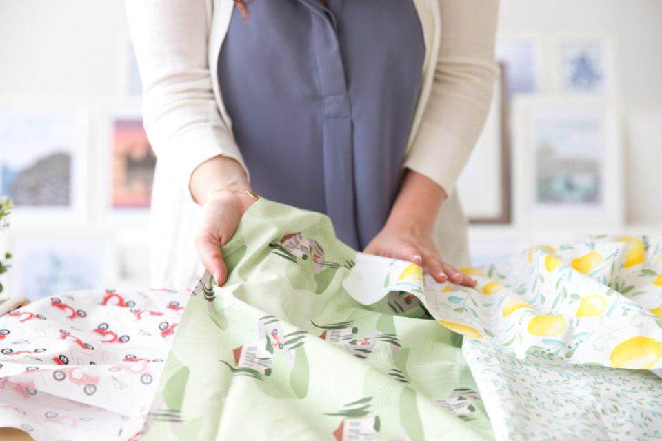Graphic Designer Emily Barrett from Fox Burrow Designs showing her fabrics
