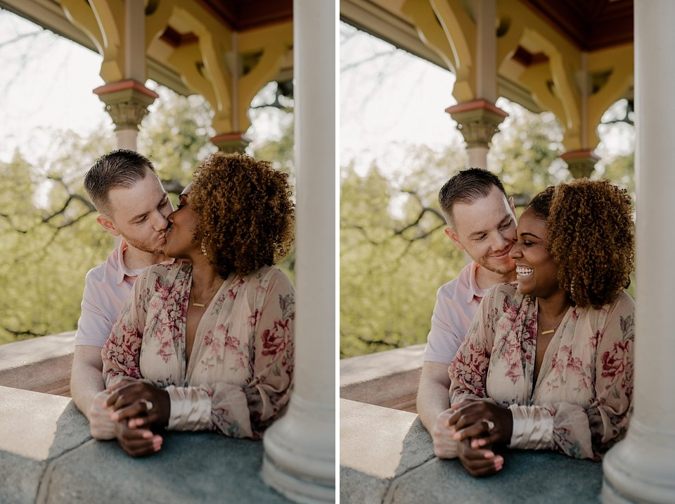 Couple kissing on porch