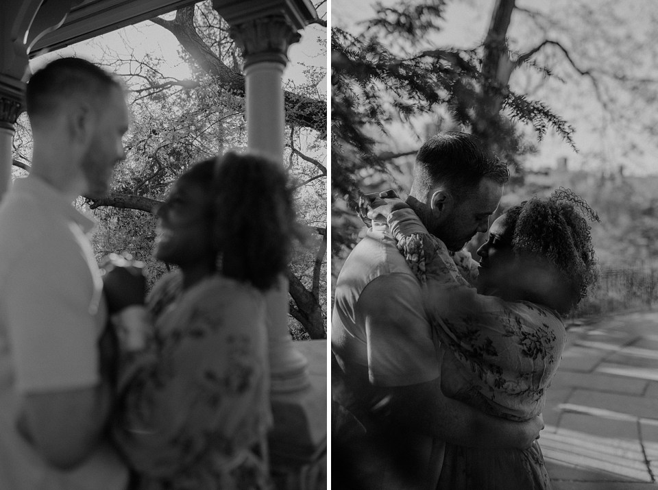 B&W blurry portrait of couple holding each other in front of trees