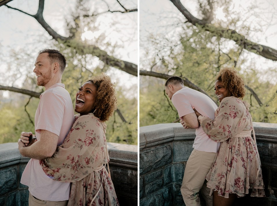 Woman holding man from behind and laughing