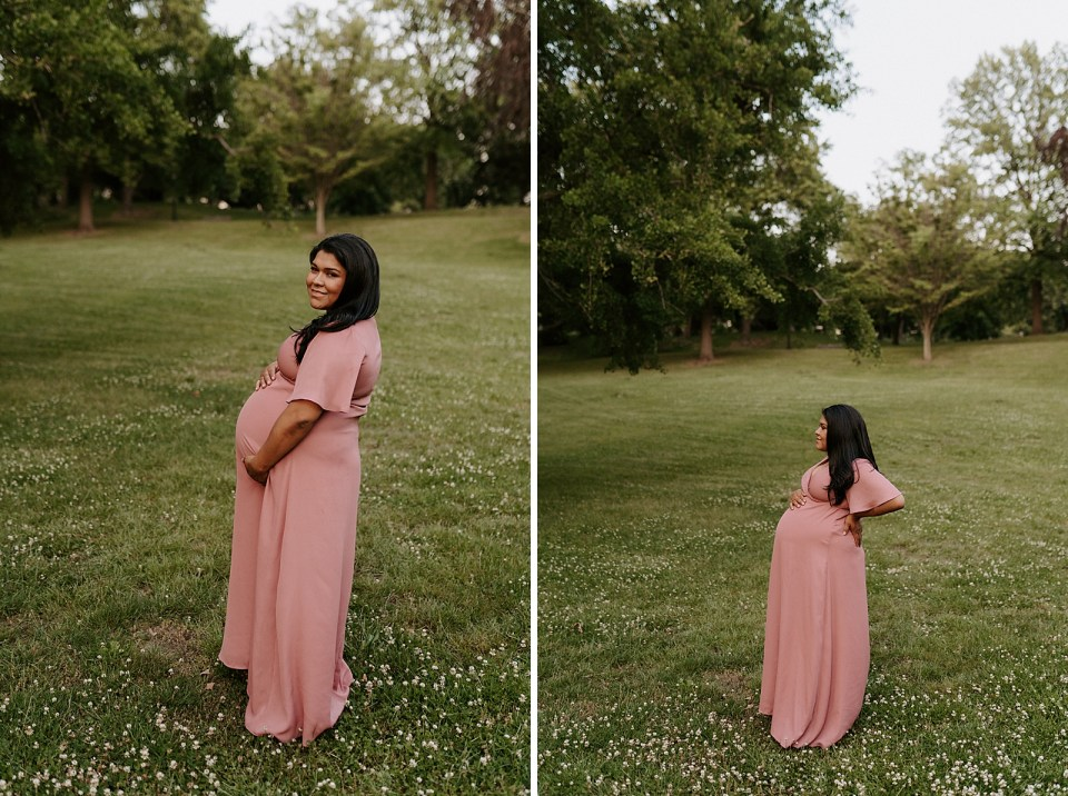 Portraits of pregnant woman on grassy field holding baby bump