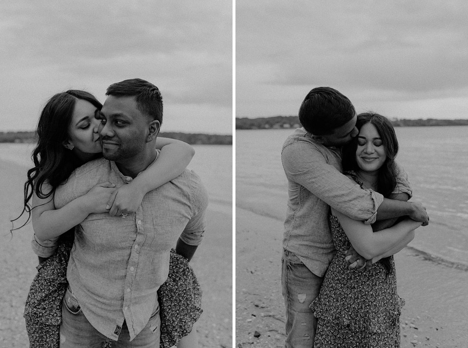 B&W woman kissing man's cheek while piggy backing