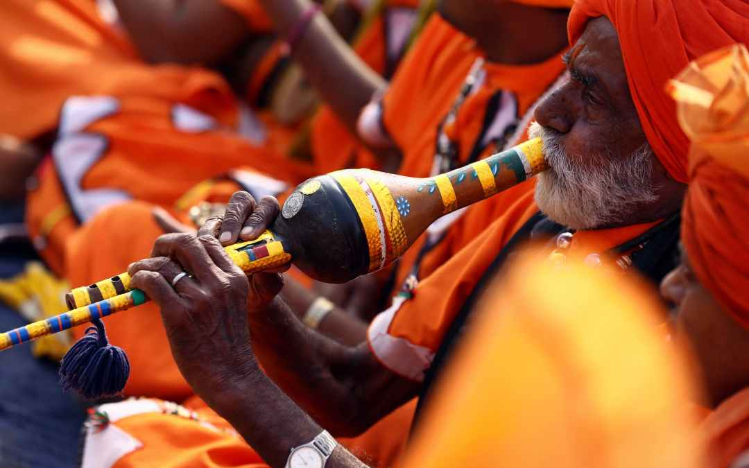 close up photo of man playing wind instrument