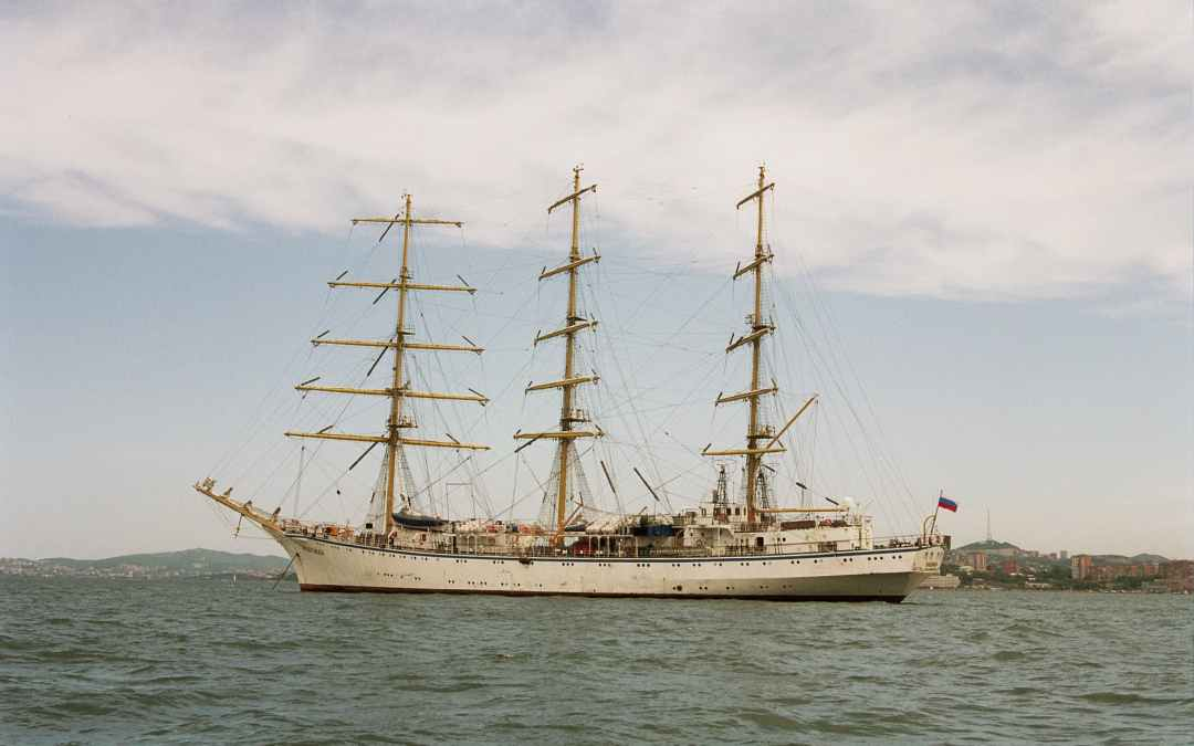 white clipper ship on ocean under cloudy sky