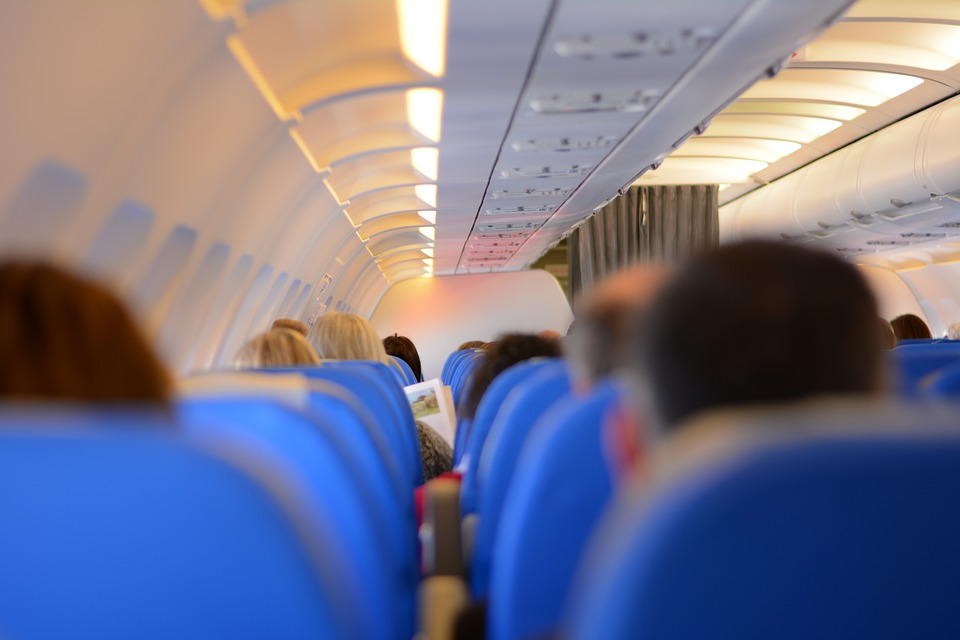 People sit on their seats on a plane