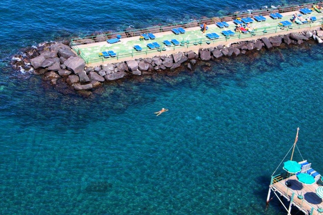 Woman swimming in the sea - Sorrento on a budget