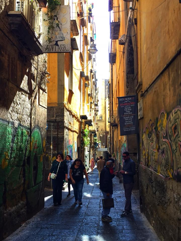 People in a small street in Naples Italy