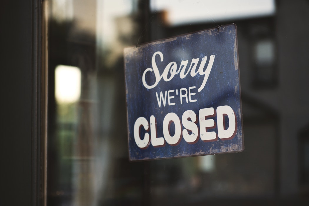 """A sign says """"sorry, we're closed"""""""