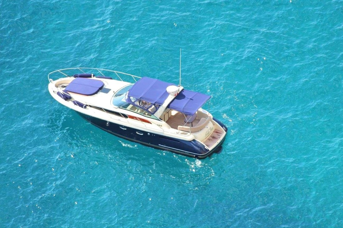Close up of a blue speedboat on light blue waters