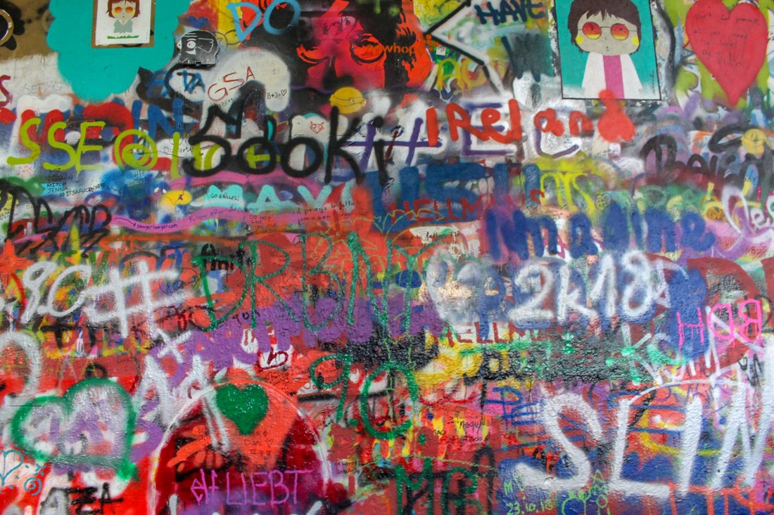 Graffiti covering the Lennon Wall in Prague