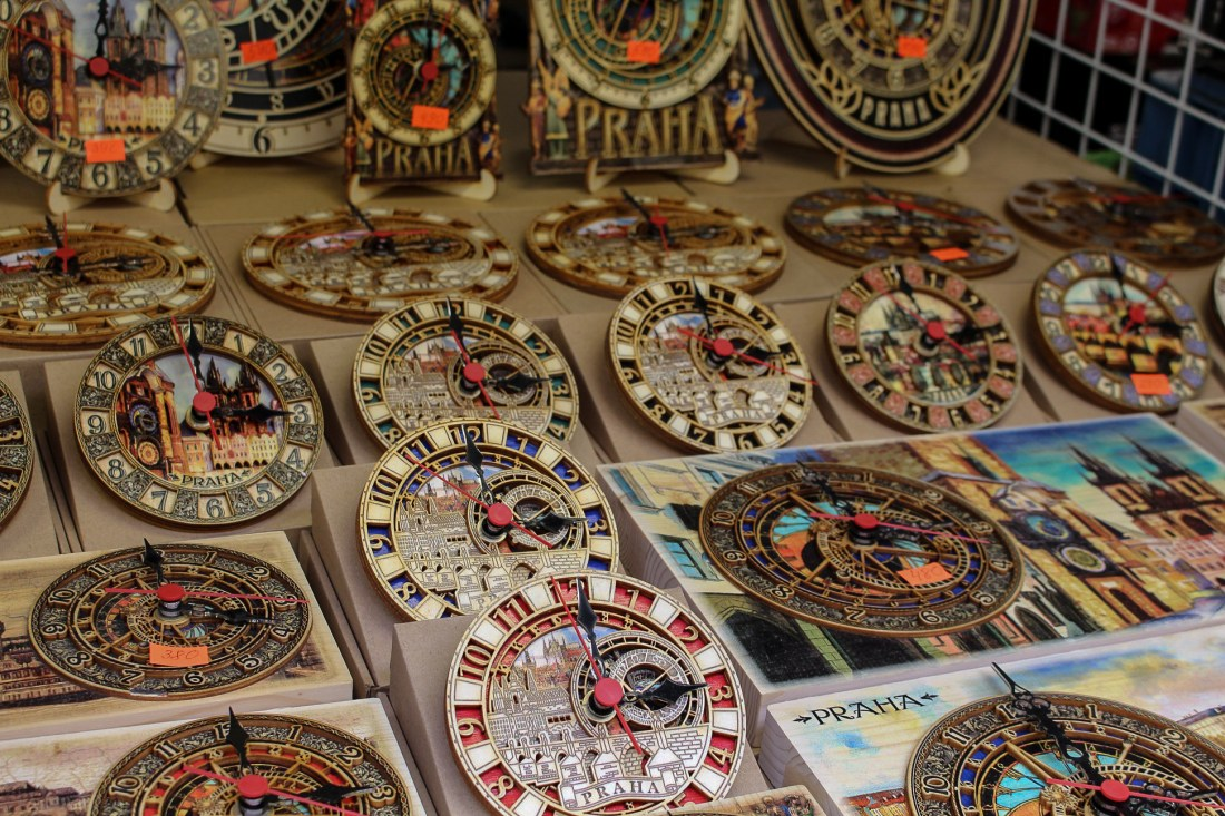 Wooden clocks on market stall, Prague