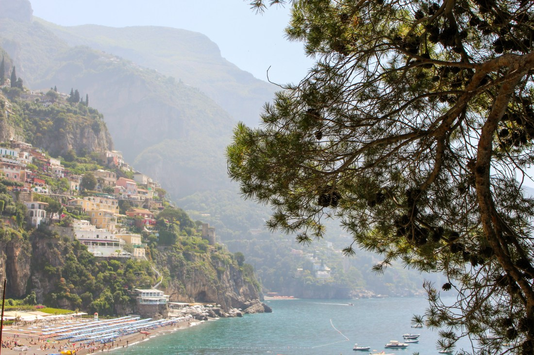 View of Positano with a tree in the foreground