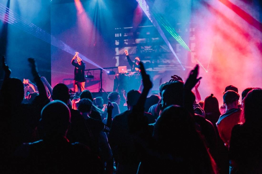 People watching a DJ in a nightclub