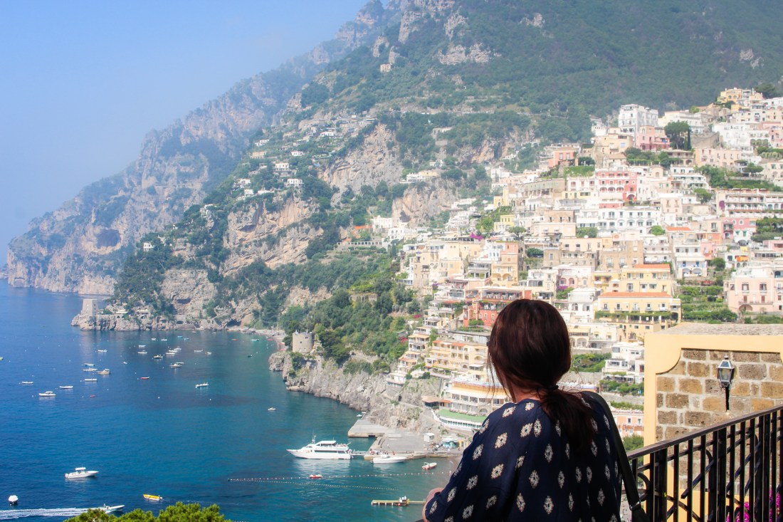 Woman looks out at the view of Positano