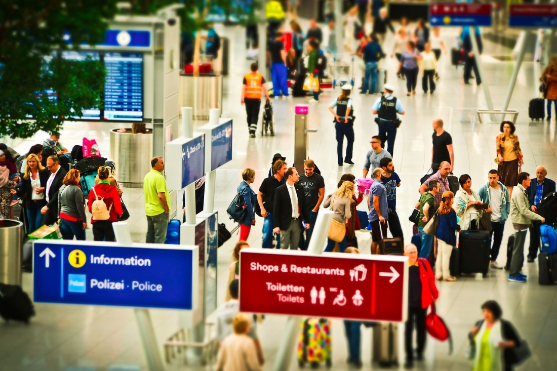 A colourful photo of a queue at an airport