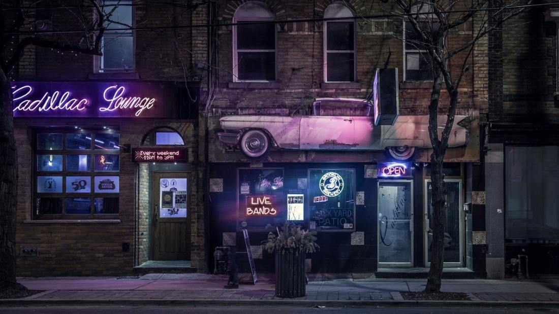 A lounge bar at night with neon purple lighting