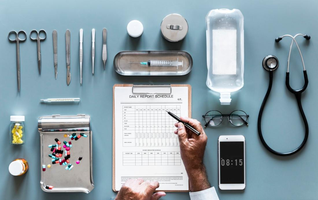 An array of medical equipment on a table with a mobile phone