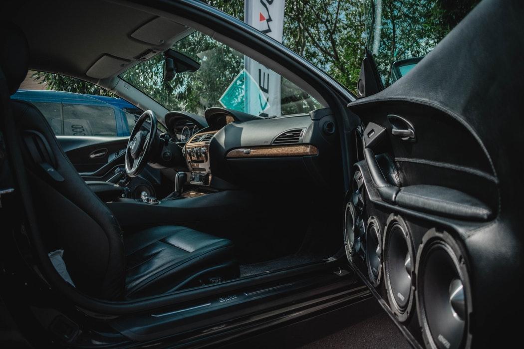 An open car door reveals the vehicle interior
