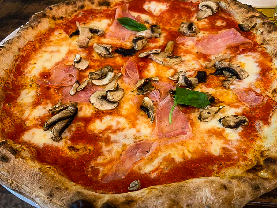 A ham and mushroom pizza from Livio, Florence