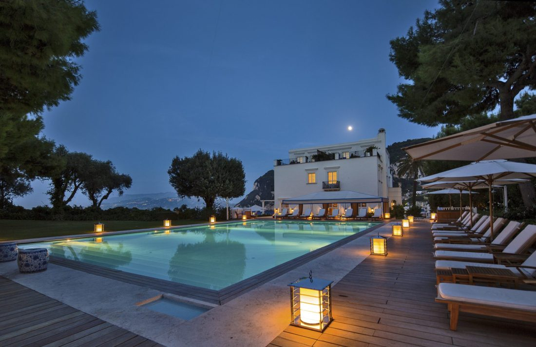 A floodlight swimming pool at J.K. Place Capri - The best hotels on the Amalfi Coast for all budgets