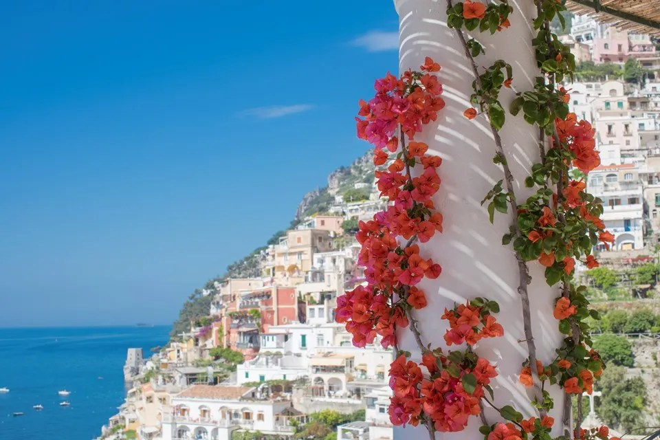 Bougainvillea grows up a pillar in Positano - The best hotels on the Amalfi Coast for all budgets