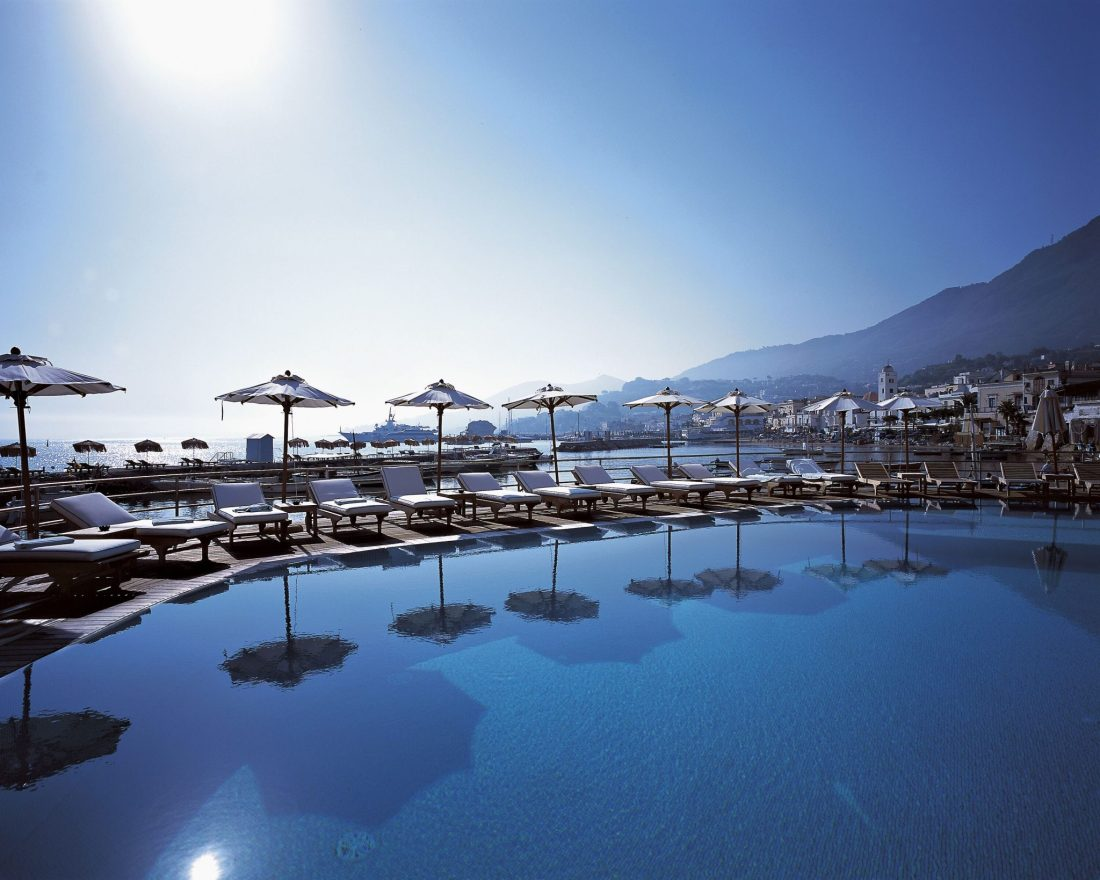 A blue swimming pool set against a blue sky - The best hotels on the Amalfi Coast for all budgets