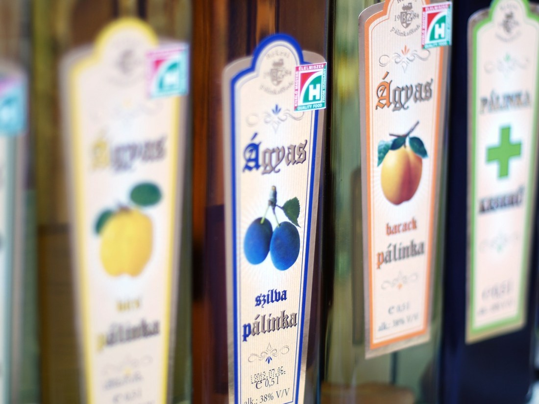 Bottles of fruit brandy, known as palinka, lined up in a row