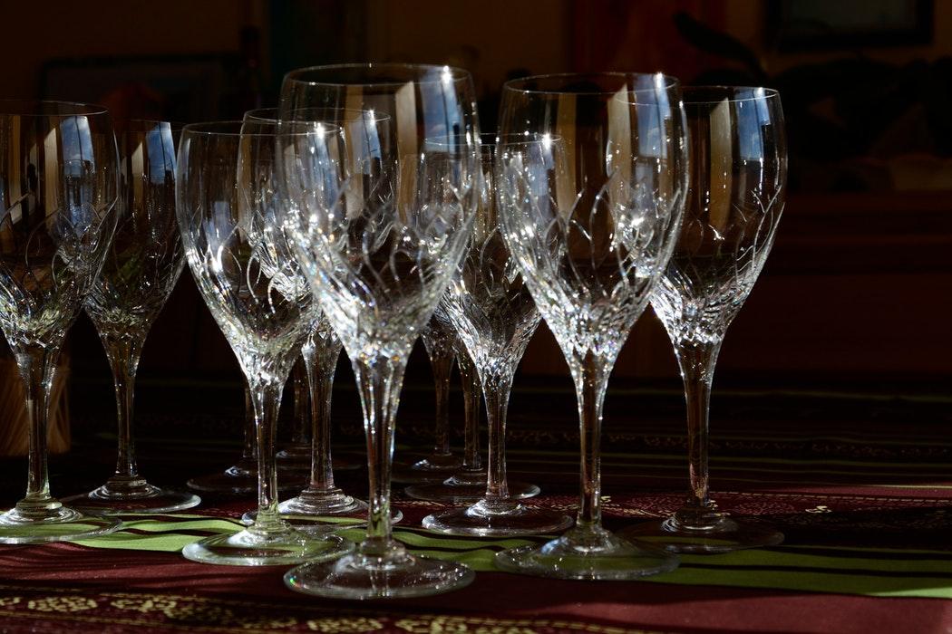 Crystal glasses set together on a wooden surface