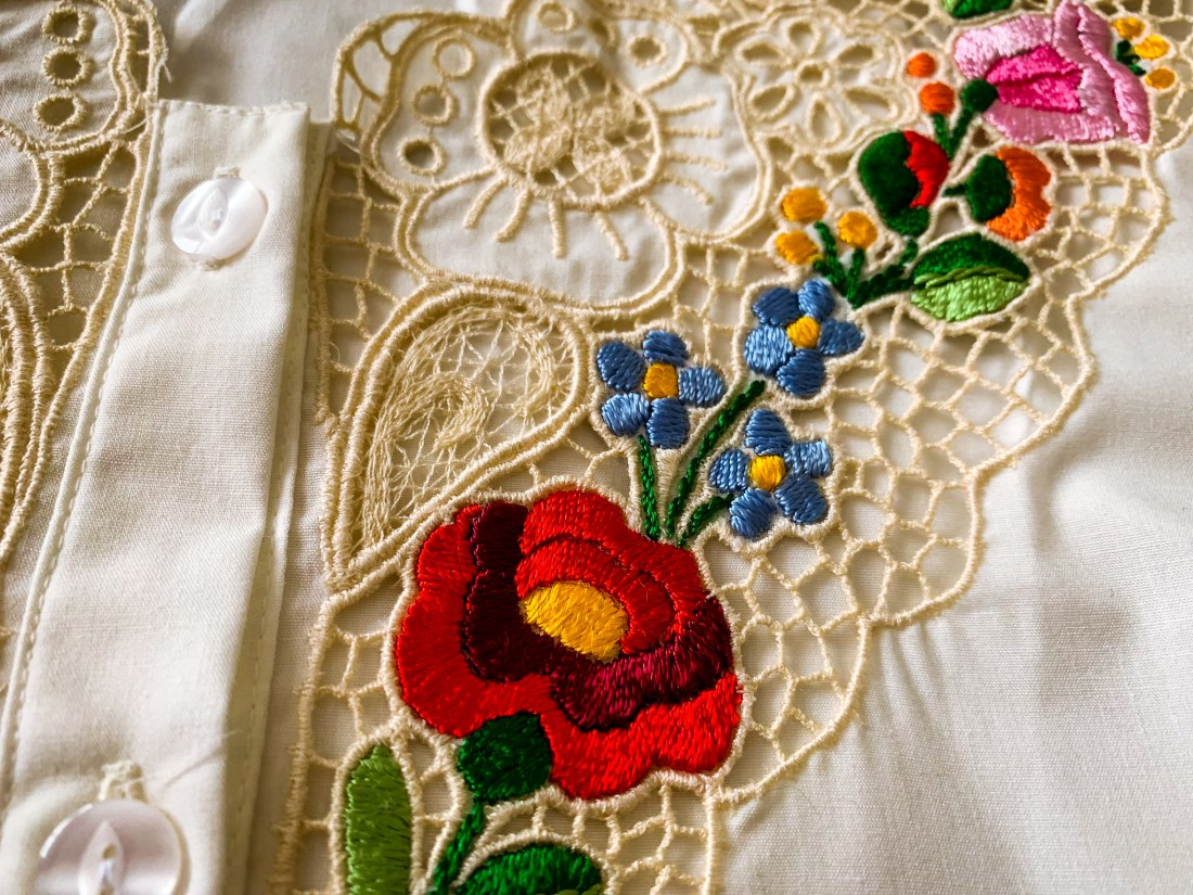 An example of Budapest shopping options - an embroidered blouse, decorated with brightly coloured flowers on lace