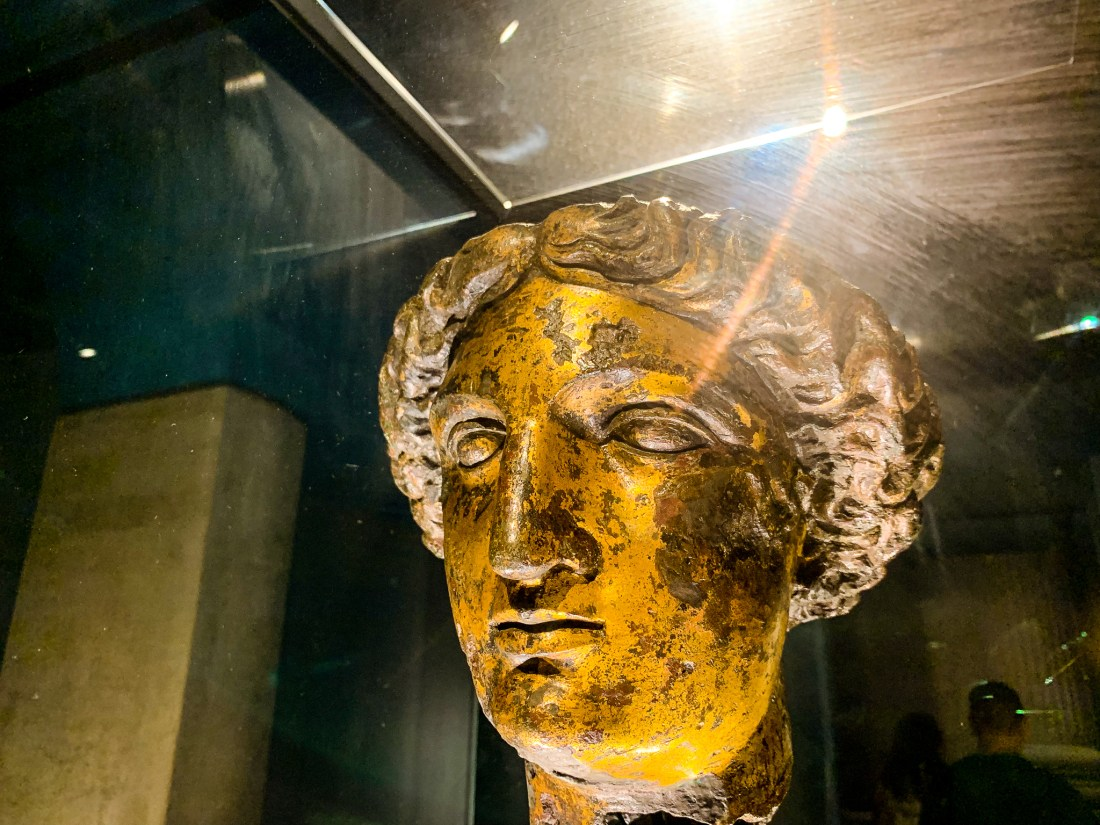 A bronze bust of the goddess Minerva, located at the Roman Baths in Bath
