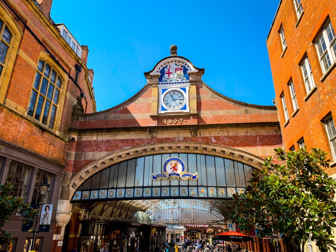 The brick entrance to the Windsor Shopping Centre, with a royal crest and clock at the top