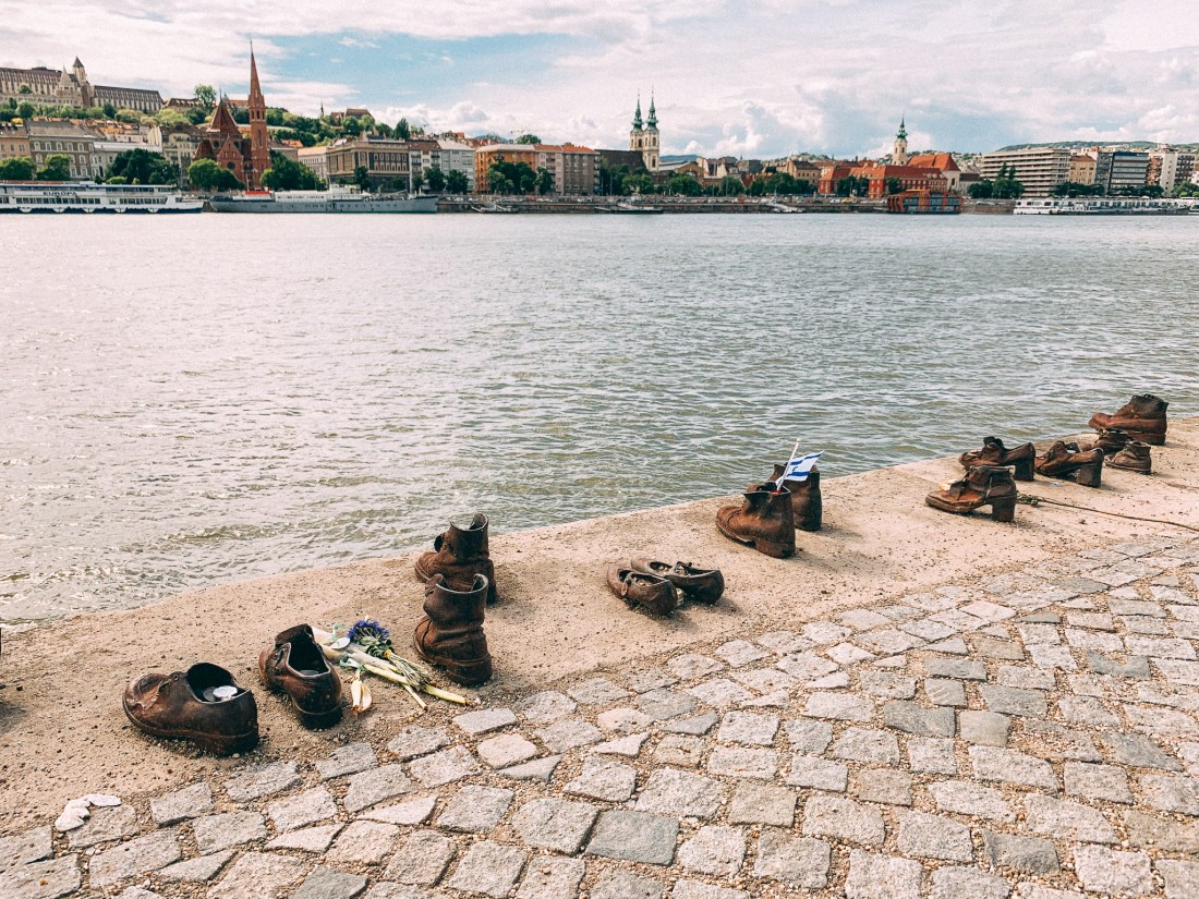 The famous artwork of the Shoes on the Danube, representing the executions of Jews in Budapest during the Second World War. The shoes stand on the bank, with the river in the background.