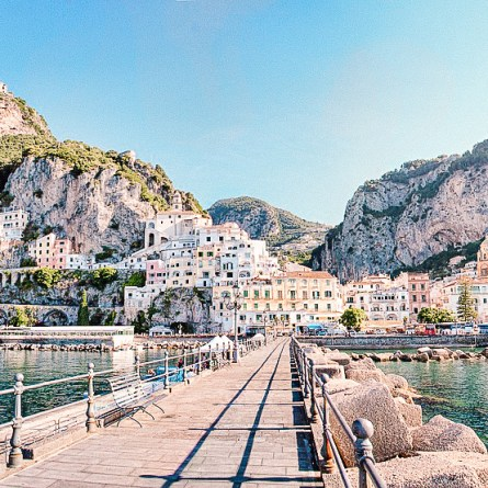 A photo of Amalfi taken from the pier in the town's harbor. One of the most instagrammable places in Amalfi.