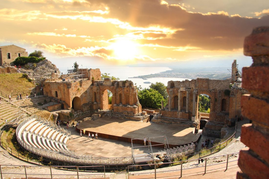 A Roman ruin in Taormina, Sicily. One of the best Italy travel tips is to visit this beautiful region.